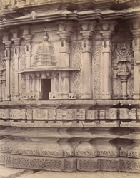 Close view of base of façade of Mukteshvara Temple, Chaudanpur, showing mouldings and sculptural details.